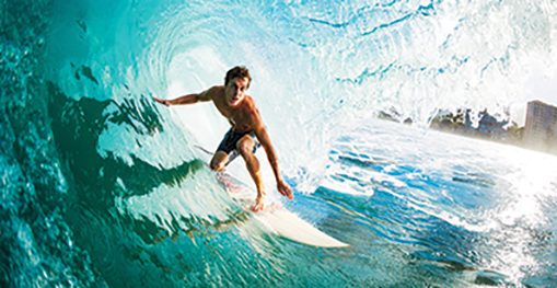 Surfer in tunnel
